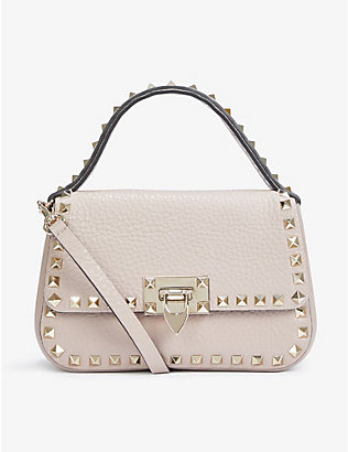 VALENTINO GARAVANI: Rockstud small leather top handle bag