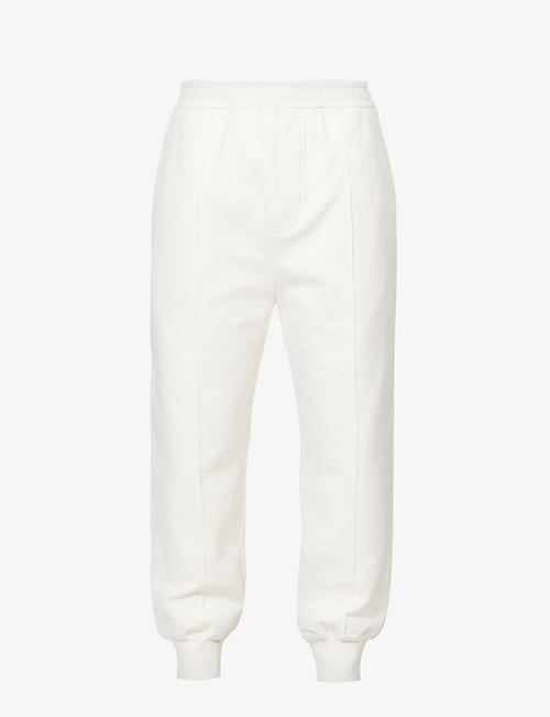 PRADA: Pin-tuck tapered cotton-jersey jogging bottoms