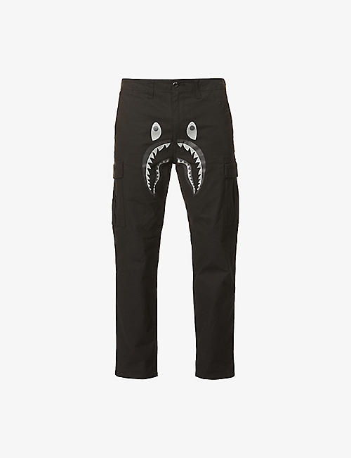 A BATHING APE: Shark-print cotton-blend trousers