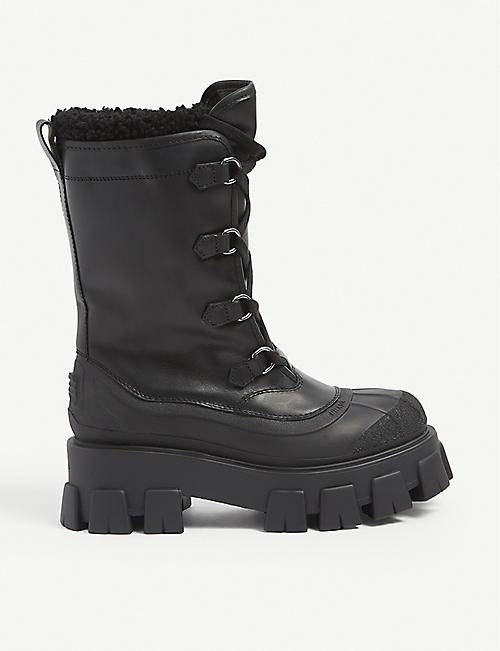 PRADA: Monolith shearling-lined leather ski boots