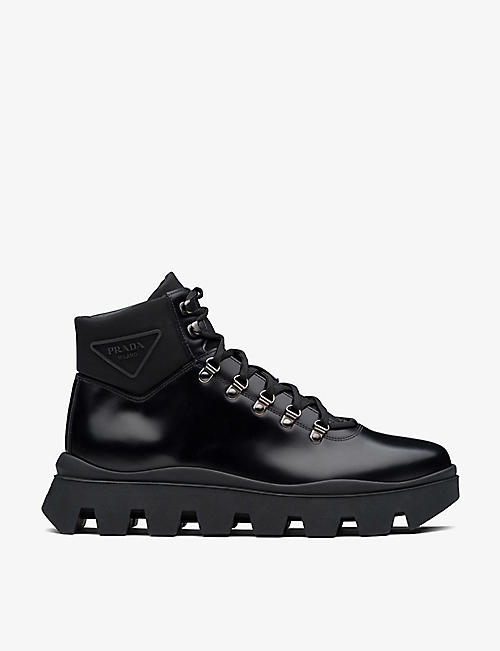 PRADA: Branded lace-up leather and nylon boots