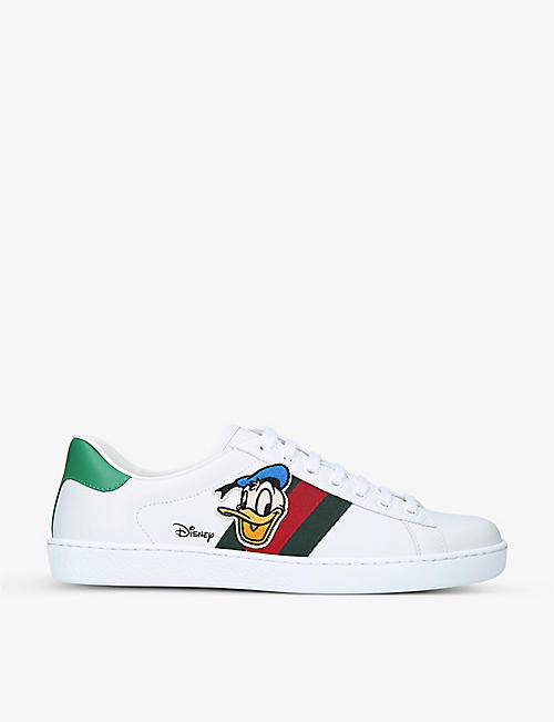 GUCCI: Women's Gucci x Disney New Ace Donald branded leather trainers