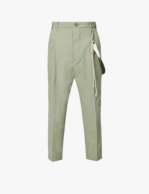 SONG FOR THE MUTE: Cropped tapered strap-embellished cotton-twill trousers