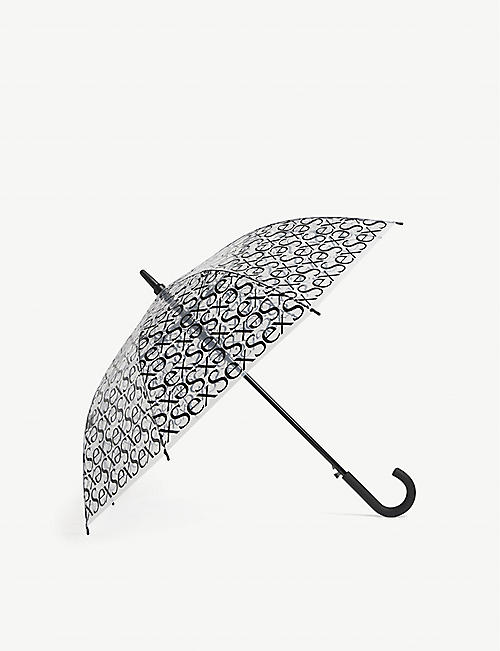 MORE JOY: Sex slogan-print umbrella