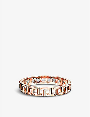 TIFFANY & CO: T True wide hinged 18ct rose gold bangle