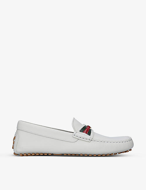 GUCCI: Ayrton logo-embellished leather driving loafers